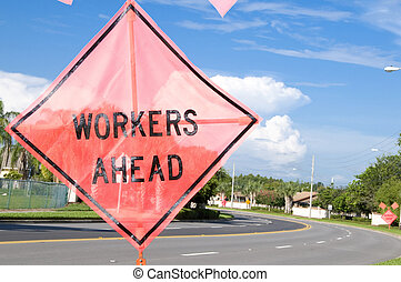 Workers Ahead - Workers ahead signs on a bend of a four lane...