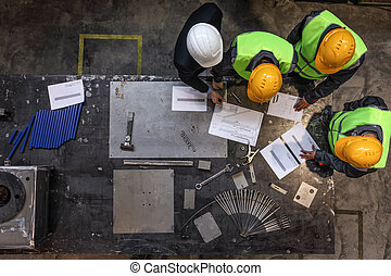 Workers and manager with documents