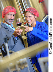 workers are checking the wine