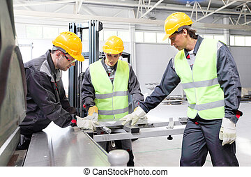 Workers at CNC machine shop