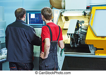 workers at manufacture workshop