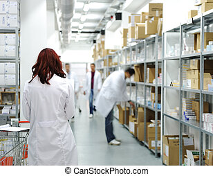 Workers at workplace, drug storage