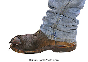 A workers steel toed boot on a white background