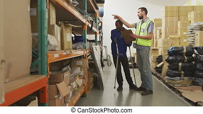 Workers checking the shelves together - Side view of an ...
