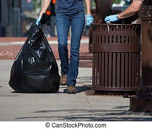 Workers Cleaning Up Garbage