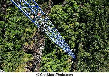 Workers climing supporting pole, Sky Bridge, Langkawi...