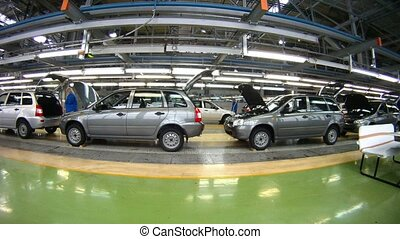 Workers do car complete set in assembly shop, time lapse