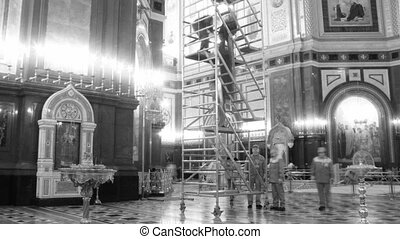 Workers do works in a temple of the Christ of the Saviour. Black-and-white color. Time lapse.