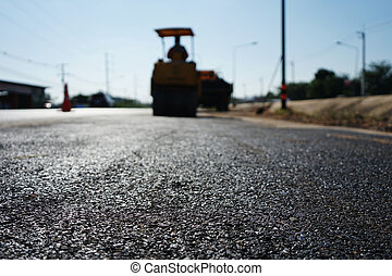 Workers fixing the road Adjusting with asphalt material (blurred image)
