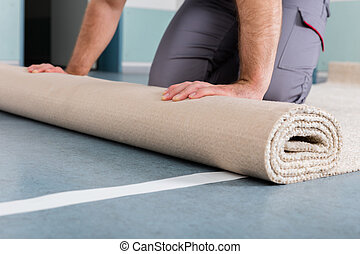 Worker's Hands Rolling Carpet - Close-up Of Worker's Hands...