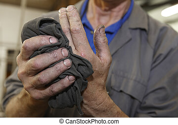 workers hands - senior worker cleaning his hands with a...