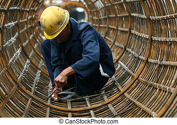 workers in bridge construction site in china