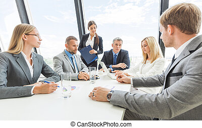Workers in business meeting