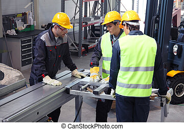 Workers in CNC machine shop
