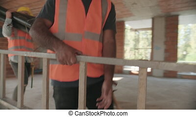 Workers In Construction Site And Building New Home