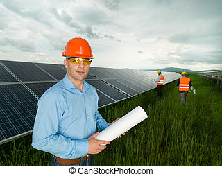workers in solar panel station