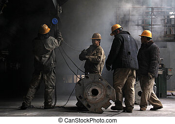 Workers in the iron and steel enterprise production line