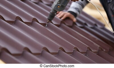 workers install metal roofing