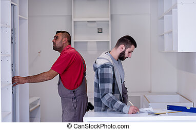 workers installing a new kitchen