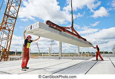 workers installing concrete slab - workers in safety...