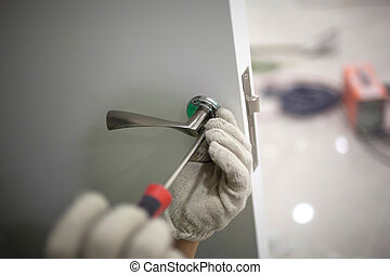 workers installing locks - workers are installing a door...