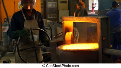 Workers melting metal in foundry workshop 4k
