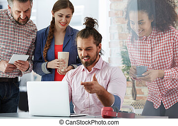 Workers of advertising agency working on new campaign