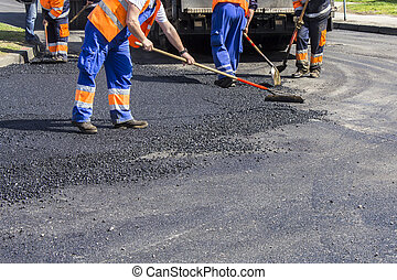 Workers on Asphalting road - Workers on Asphalting paver ...