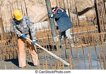 workers on concrete works - two builder workers during...