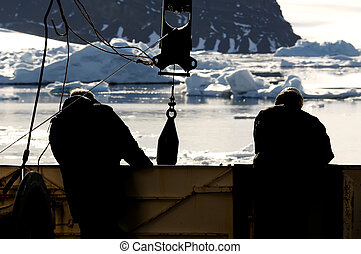 Workers on vessel in Antarctica - Two workers on a research ...