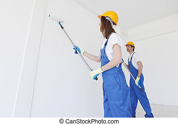 Workers painting the wall