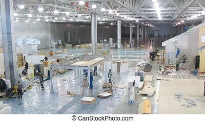Workers prepare stands for exhibition MOSBUILD 2011 - MOSCOW...
