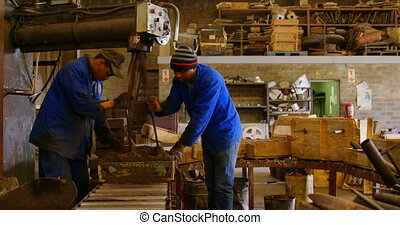 Workers putting soil in mold in foundry workshop 4k
