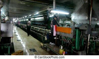 Workers reeling at workshop.Silk