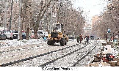 Workers repair road to city.