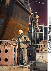 workers repaired the ship in dry dock