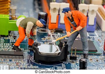 workers repairing computer motherboard