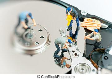Workers repairing hard drive.