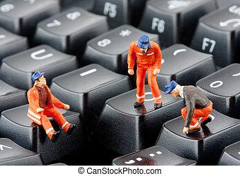 Workers repairing keyboard