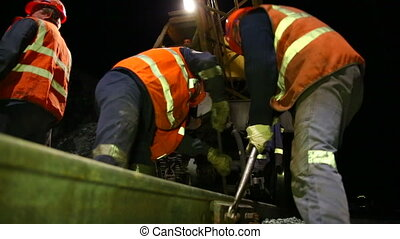 Workers repairing the railroad tracks and rails.