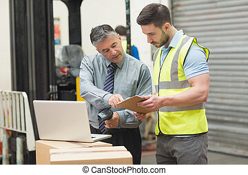 Workers scanning package in warehouse - Portrait of manual...
