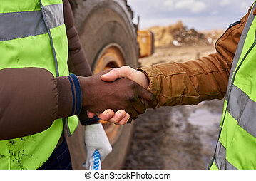 Workers Shaking Hands Outdoors Closeup