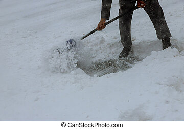 Workers sweep snow from road in winter, Cleaning road from ...