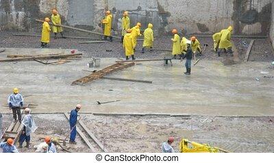 Workers under rain