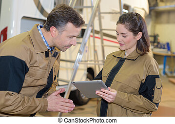 workers using digital tablet in warehouse