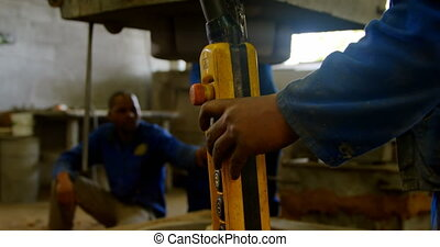 Workers using overhead crane in foundry workshop 4k - ...