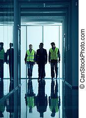 Workers walking in corridor