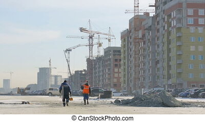 Workers walking to the construction site