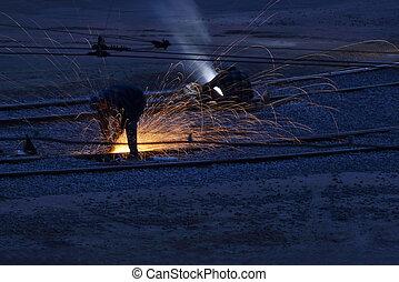 workers welders repair metal rails