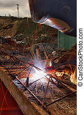 Workers welding steel